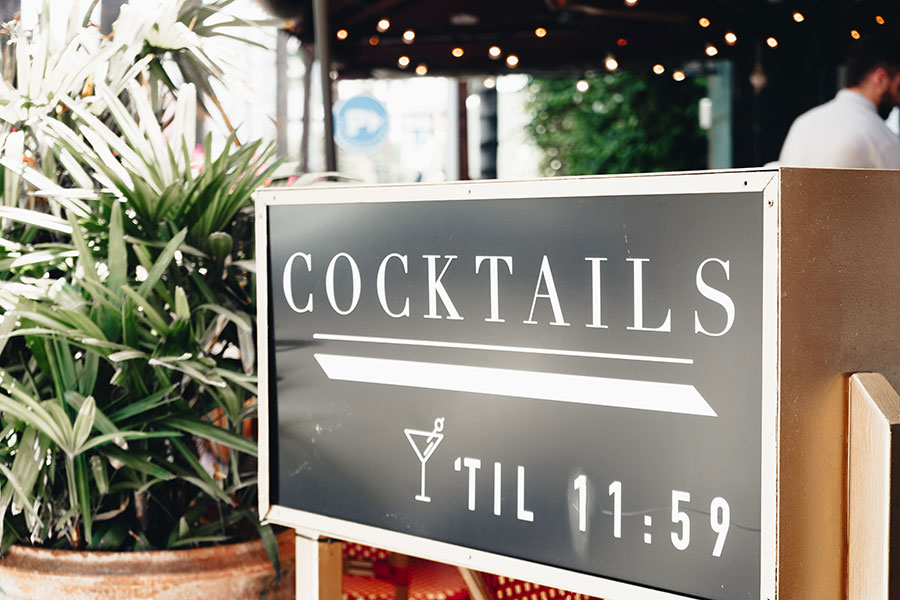 Cocktail sign open until 12midnight at WeHo Bistro